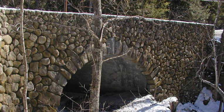 stone arch with snow